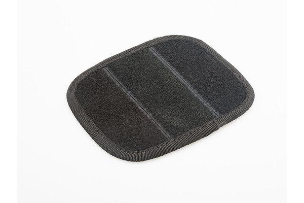 Almohadilla con velcro para alforjas textiles Como cobertura adicional del cierre de velcro.